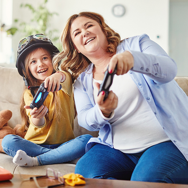 mother and daughter playing and having fun at home